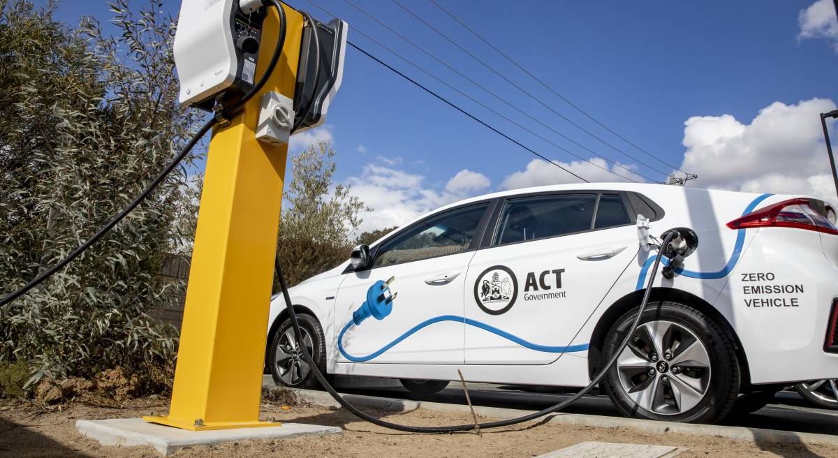 An ACT government vehicle charges at a new electric vehicle charging station at the West Belconnen Child and Family Centre in Holt. Picture: Sitthixay Ditthavong