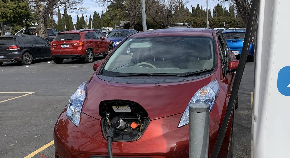 An electric vehicle plugged into a recharging station in Civic. Picture: Peter Brewer